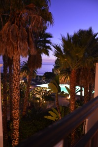 At dusk overlooking pool and ocean.