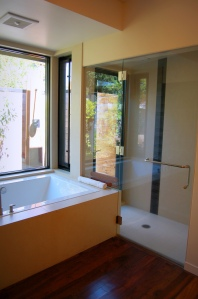 Walk-in shower with door to outdoor shower.